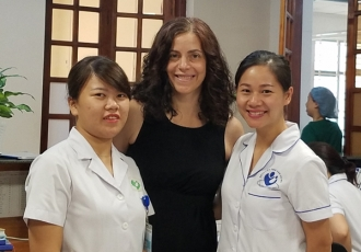Maria Gallo, PhD, with health care team at Hanoi Hospital in Vietnam.