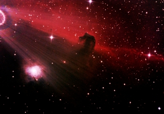 photo of the Horsehead Nebula (also known as Barnard 33). The Horsehead Nebula is a dark nebula in the constellation Orion and is approximately 1,500 light-years from Earth. Though difficult to see visually, it is one of the most identifiable nebulae because images of its swirling cloud of dark dust and gases bear remarkable resemblance to a horse's head when viewed from Earth.