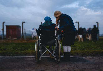 caregiver with person in wheelchair