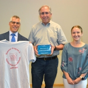 Stanley Lemeshow (center), professor of biostatistics and founding dean of CPH, received an award by CPHP director Andy Wapner and program manager Colleen Fitzgibbons.